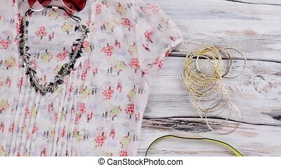 Necklace and summer blouse. Lime purse, blouse and...