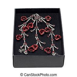 Necklace in black velvet box