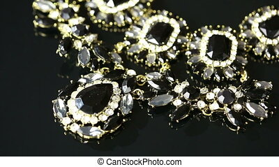 Necklace on a black background - Necklace with crystals on a...