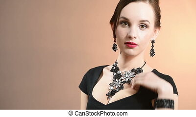 necklace on the neck. portrait of a beautiful girl