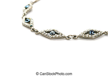Necklace with blue and white gemstones isolated on white...
