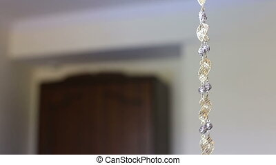 necklace show on wall
