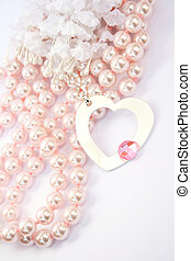 Necklace with heart medallion with pink stone on it, pink...