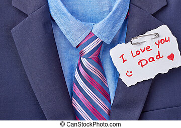 Necktie and Father's Day card. Tuxedo and inscription on...