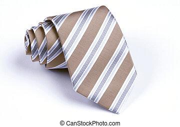 Necktie - beige, blue and white striped necktie rolled up on...