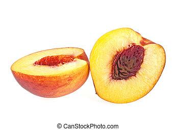 Nectarine fruit halves isolated on white background, close...