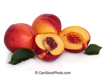 Nectarine fruit whole and in halves with leaf sprigs, isolated over white background with reflection.