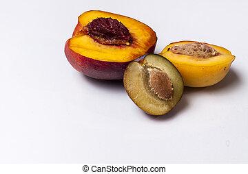 Nectarine, peach and plum - white background.