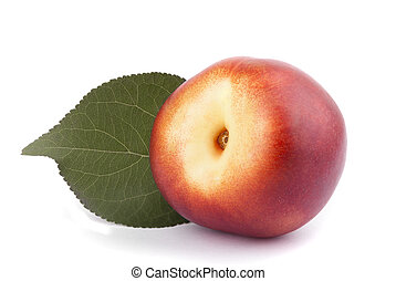 Nectarine with green leaf on a white background.