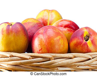 nectarines in a wattled basket