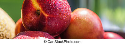 Nectarines with drops of water