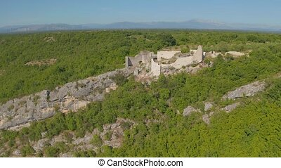 Necven fortress remains on the west side of mountain Promina...