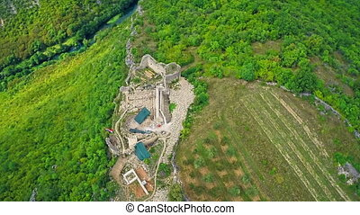 Necven medieval fortress, aerial - Copter aerial view of the...