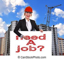 Need a job - Engineer woman holding placard with need a job