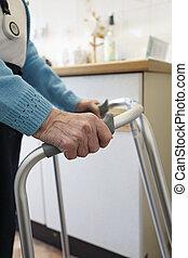 Elderly lady using a walking frame