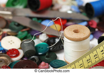 Needle and a thread. A set of accessories for sewing.