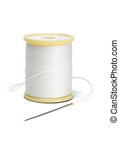 Needle and spool of thread on white background