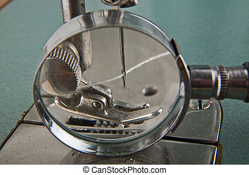 needle and thread in a sewing machine