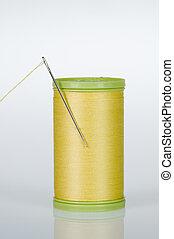 Needle and thread - Yellow