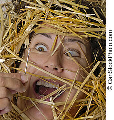Needle in Haystack - Woman finds a needle in a haystack--to...