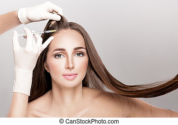 Cosmetic been injected in woman's head.