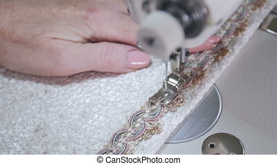 Needle of the sewing machine sews fabric. Close up. Slow...