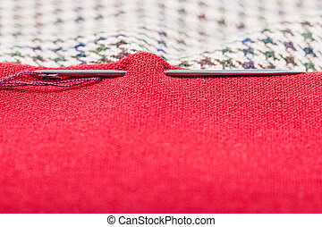 needle sews two pieces of cloth