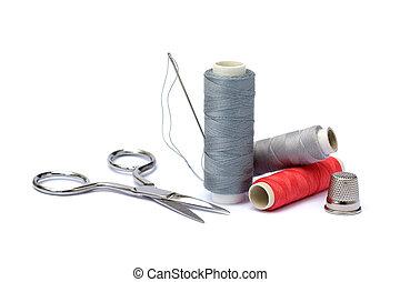 Needle, thimble, scissors, thread
