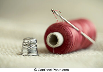 Needle, thread and thimble