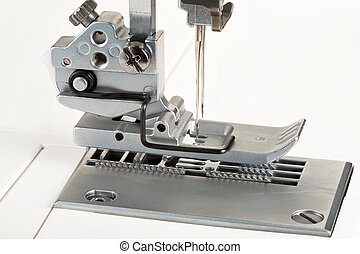 needles and foot of sewing machine