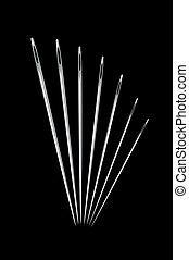 Needles on black