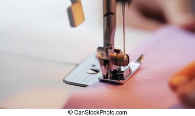 sewing machine presser foot stitching fabric - needlework...