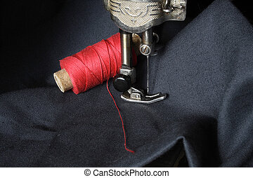 Needlework - Close-up of old sewing-machine and red sewing