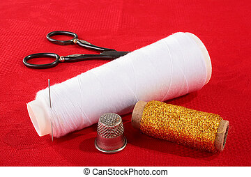 Needlework - Set for house needlework on a red background.