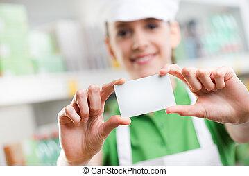 negócio, escriturário, vendas, segurando, em branco, cartão