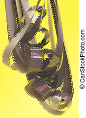 Negative photographic film on yellow background.