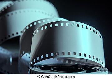 Negative reel of film on a dark background.