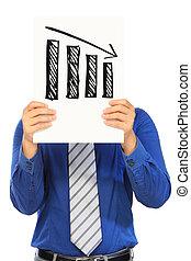 Negative Trend - A man holding a sketch of a bar chart ...