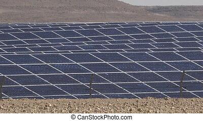Photovoltaics in desert solar power farm in the Negev desert, Israel