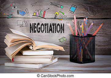 Negotiation. Stack of books and pencils on the wooden table.