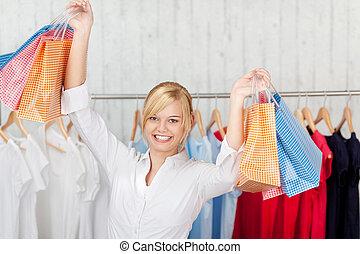 negozio, borse, elevato, shopping donna, braccia, portante