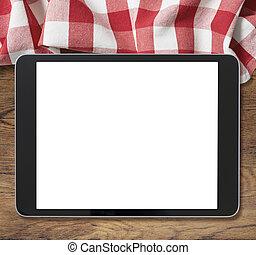 negro, computadora personal tableta, en, tabla de madera, y, picnic, mantel