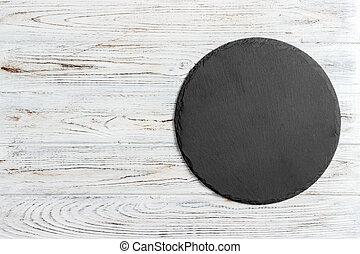 negro, pizarra, redondo, piedra, en, de madera, plano de fondo, punta la vista, espacio de copia