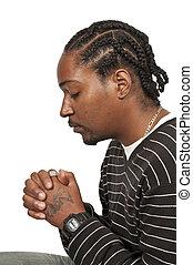 negro, rezando