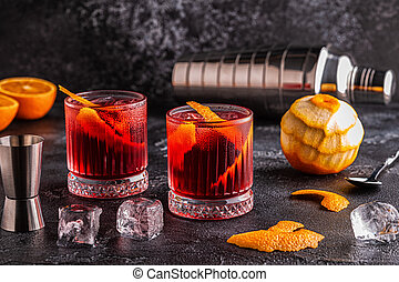 Negroni cocktail with orange peel and ice. - Negroni ...