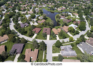 Neighborhood Aerial View With Pond