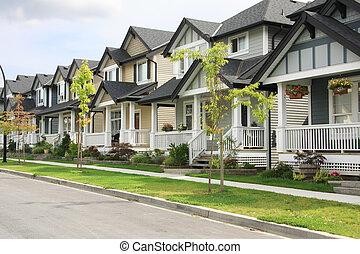 Neighborhood. - Friendly neighborhood of townhouses.