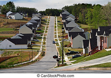 Neighborhood of midsize homes - Looking up the street of a...
