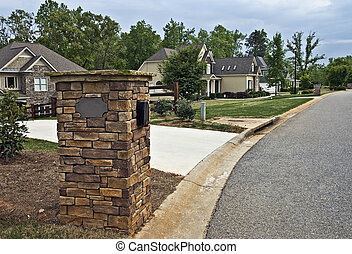 Neighborhood Street - Houses and mailboxes along a street in...