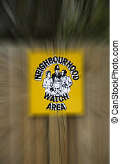 Neighbourhood watch poster surrounded by a blurred out background